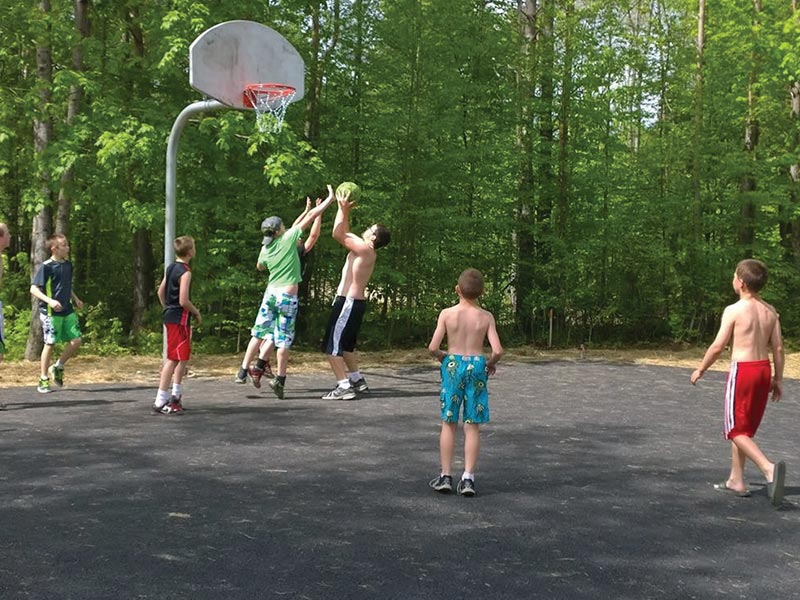 campers playing basketball in RV park