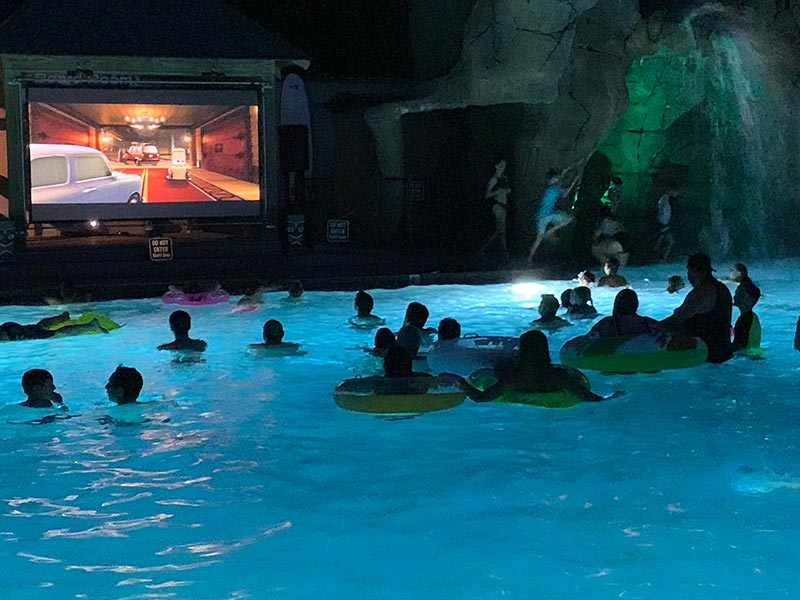 campers enjoying swim in movie theater at Moose Hillock RV Park
