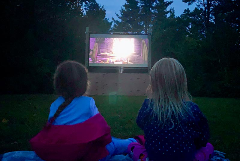 campers enjoying the outdoor theater at Moose Hillock RV Park in Lake George, NY