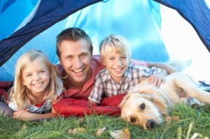 Dad with 2 kids and dog in tent