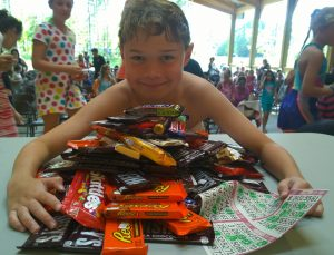 kid with large pile of candy
