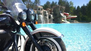 Motorcycle parked in front of pool