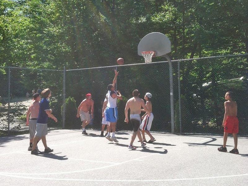 Group playing basketball
