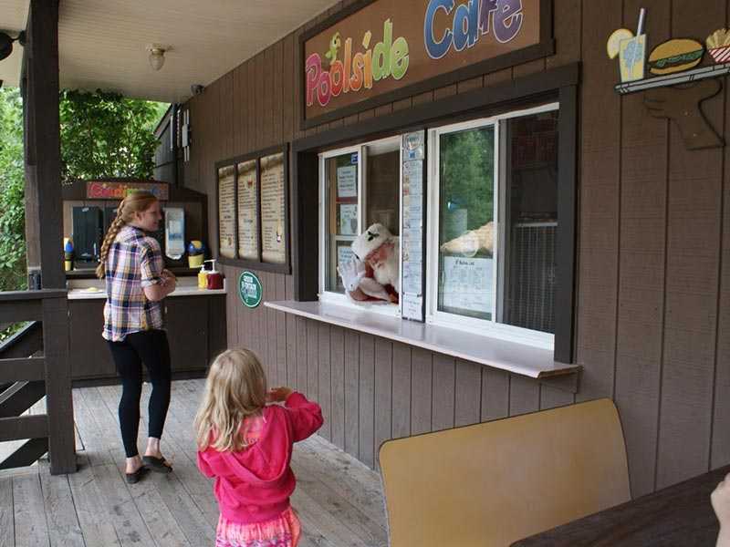 Kids getting ice cream from ice cream window
