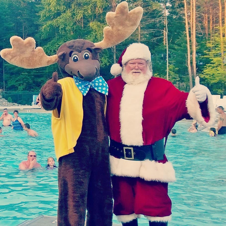Santa and moose mascot giving thumbs up