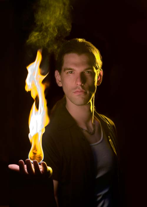 Man holding flaming ball