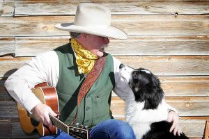 Cowboy with dog and guitar