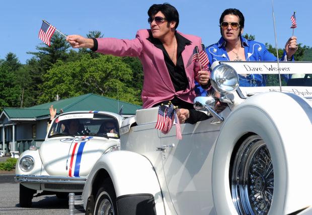 Elvis impersonators in classic white car