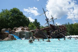 Pool with pirate ship water feature
