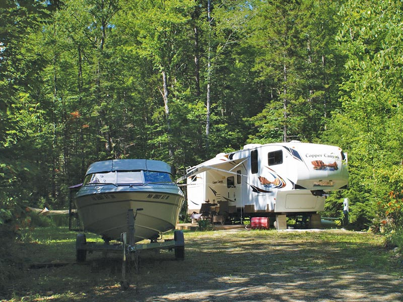 Campsite with RV trailer and boat