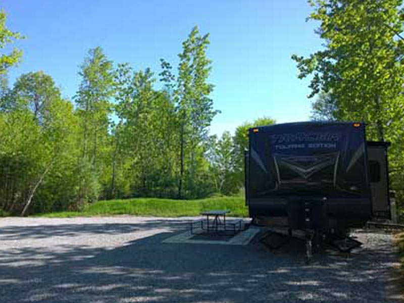 RV campsite with trailer and table