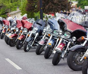 Motorcycles lined up on street